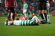 14th October 2017, Celtic Park, Glasgow, Scotland; Scottish Premiership football, Celtic versus Dundee; Celtic's Cristian Gamboa and Dundee's Jack Hendry on the ground after clashing heads
