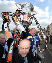 Bristol Rovers Kitman, Tom Foley with the Vanarama Conference Play-Off final trophy - Photo mandatory by-line: Dougie Allward/JMP - Mobile: 07966 386802 - 25/05/2015 - SPORT - Football - Bristol - Bristol Rovers Bus Tour