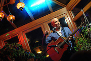 Birmingham, England. 23rd. October, 2016. <br /> Dave Rogers, Birmingham based singer, songwriter and cultural activist, performing at the 'Up Close and Personal' concert, produced by Kalaboration as part of their Bridges Across Borders series of events in Kings Heath Birmingham.<br /> Photographer, Kevin Hayes