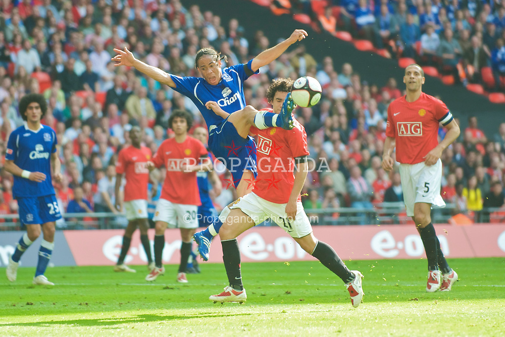 LONDON, ENGLAND - Sunday, April 19, 2009: Manchester United's Rafael da Silva pushes Everton's Steven Pienaar down in the box, but no penalty is awarded, during the FA Cup Semi-Final match at Wembley. (Photo by David Rawcliffe/Propaganda)