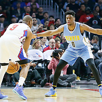 24 February 2016: Denver Nuggets guard Emmanuel Mudiay (0) defends on Los Angeles Clippers guard Chris Paul (3) during the Denver Nuggets 87-81 victory over the Los Angeles Clippers, at the Staples Center, Los Angeles, California, USA.