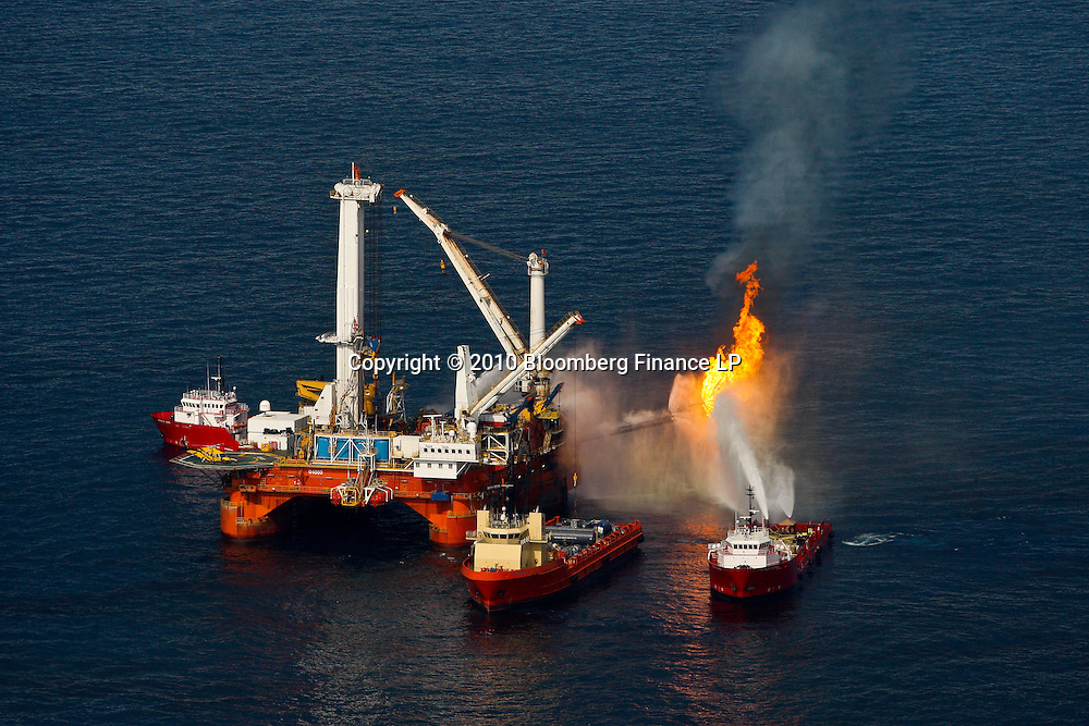 The BP Plc leased Q4000 vessel burns off oil and gas it collects at the site of the BP Plc Deep Water Horizon oil spill in the Gulf of Mexico off the coast of Louisiana, U.S., on Saturday, June 19, 2010. The BP Plc oil spill, which began when the leased Transocean Deepwater Horizon oil rig exploded on April 20, is gushing as much as 60,000 barrels of oil a day into the Gulf of Mexico, the government said. Photographer: Derick E. Hingle/Bloomberg