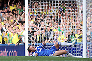 John Terry of Chelsea is unable to stop Norwich's Grant Holt's shot from hitting the net for the equaliser as the Norwich fans celebrate during the Barclays Premier League match at Stamford Bridge stadium, London...Picture by Paul Chesterton/Focus Images Ltd.  07904 640267.27/8/11