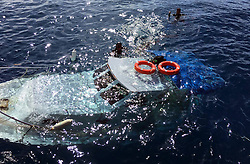 Members of the Turkish coast guard search near a capsized boat on the Aegean Sea, Turkey, on March 6, 2016. At least 18 refugees drowned on Sunday when two boats capsized off Turkey's Aegean coast while attempting to reach a Greek Island, Turkish media reported. EXPA Pictures © 2016, PhotoCredit: EXPA/ Photoshot/ Merit Macit<br /> <br /> *****ATTENTION - for AUT, SLO, CRO, SRB, BIH, MAZ, SUI only*****