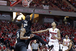 20 March 2017:  watching the ball drop are A.J. Davis, Tacko Fall and Phil Fayne(10) during a College NIT (National Invitational Tournament) 2nd round mens basketball game between the UCF (University of Central Florida) Knights and Illinois State Redbirds in  Redbird Arena, Normal IL