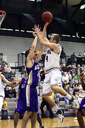 30 December 2006: Mike Harrigan leans over Andrew Holms for a shot. The Titans outscored the Britons by a score of 94-80. The Britons of Albion College visited the Illinois Wesleyan Titans at the Shirk Center in Bloomington Illinois.<br />