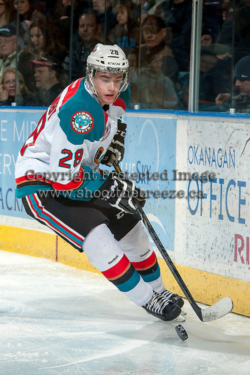 KELOWNA, CANADA -FEBRUARY 1: Joe Gatenby #28 of the Kelowna Rockets skates behind the net with the puck against the Kamloops Blazers on February 1, 2014 at Prospera Place in Kelowna, British Columbia, Canada.   (Photo by Marissa Baecker/Getty Images)  *** Local Caption *** Joe Gatenby;
