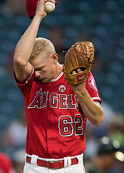 August 30, 2017 - Anaheim, CA, USA - Los Angeles Angels starting pitcher Parker Bridwell wipes his brow during a humid first inning against the Oakland Athletics at Angel Stadium in Anaheim, CA on Wednesday, August 30, 2017. (Photo by Kevin Sullivan, Orange County Register/SCNG) (Credit Image: © Kevin Sullivan/The Orange County Register via ZUMA Wire)