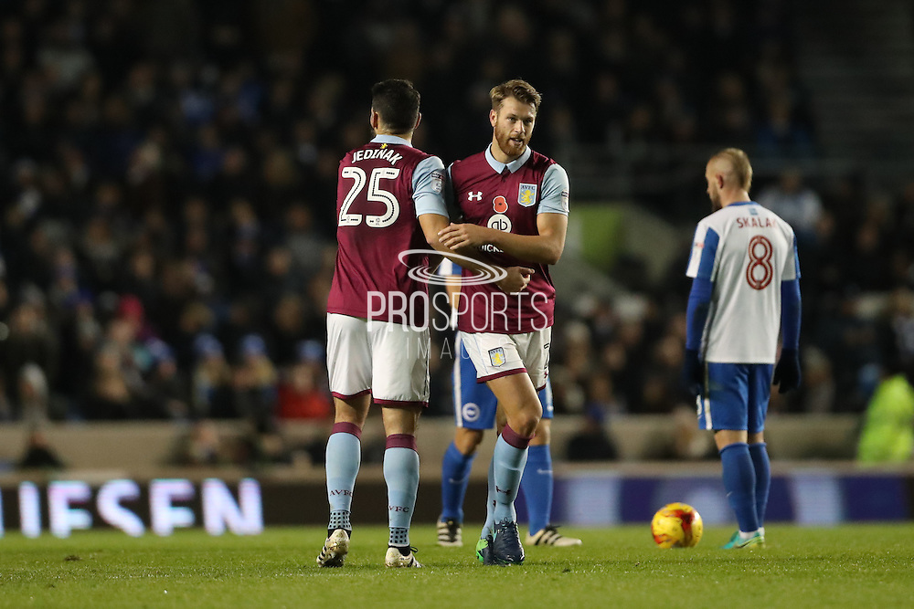 Aston Villa defender Nathan Baker (2) scores a goal 1-0 and celebrates with Aston Villa midfielder Mile Jedinak (25) during the EFL Sky Bet Championship match between Brighton and Hove Albion and Aston Villa at the American Express Community Stadium, Brighton and Hove, England on 18 November 2016.
