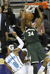 October 17, 2018 - Charlotte, NC, USA - The Milwaukee Bucks' Giannis Antetokounmpo (34) gets a dunk over the Charlotte Hornets' Miles Bridges (0) in the second half at the Spectrum Center in Charlotte, N.C., on Wednesday, Oct. 17, 2018. The Bucks won, 113-112. (Credit Image: © David T. Foster Iii/Charlotte Observer/TNS via ZUMA Wire)