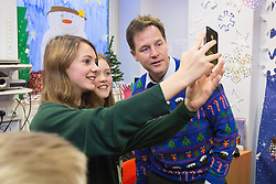 © Licensed to London News Pictures . 12/12/2014 . Sheffield , UK . EMBARGOED UNTIL 00:01 22 December 2014 . Two of the children pose for a selfie with Nick Clegg after the recording . Special Christmas edition of radio show Call Clegg recorded at Sheffield Children's Hospital , with Deputy Prime Minister Nick Clegg taking questions from children on the ward , hosted by Nick Ferrari . Photo credit : Joel Goodman/LNP