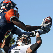 11/5/163:17:14 PM ---Football----<br /> <br /> Orange Coast College right wing James Rutledge (18) reaches for the pass in the end zone while Fullerton College defensive back Tim Gordon blocks the attempt on Nov. 5,  2016. Fullerton College defeated Orange Coast College 35-14 adding another win to their current record of 8-1.<br /> <br /> Photo by Claire Rounkles, Sports Shooter Academy