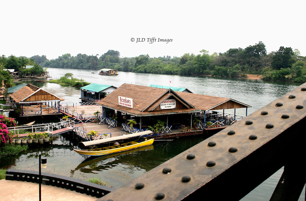 Bridge on the River Kwai, current version, looking down on floating restaurants in the river.
