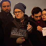 People hold up signs declaring 'Je suis Charlie'. Londoners show their solidarity with the 12 people killed in an attack on the magazine Charlie Hebdo in Paris and their revulsion of the attack on freedom of speech at a vigil in Trafalgar Square. Three attackers killed ten journalist working for Charlie Hebdo and two police officers, the worst terrorist attack in Paris, France in 50 years.
