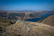 A small cairns, man-made stack of stones, marks the trail for hikers along the path up the western side of Helvellyn Mountain, Lake District, Cumbria, UK.  Behind the carins is stunning green valleys of Wythburn and Armboth Fells and Thirlmere reservoir.  Helvellyn is the third-highest point in England and is located in the beautiful Lake District National Park and part of the Eastern Fells.  (photo by Andrew Aitchison / In pictures via Getty Images)