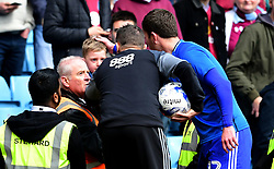 Birmingham City first team coach Steve Cotterill and Craig Gardner of Birmingham City comfort a young fan who was struck by a stray ball  - Mandatory by-line: Joe Meredith/JMP - 23/04/2017 - FOOTBALL - Villa Park - Birmingham, England - Aston Villa v Birmingham City - Sky Bet Championship