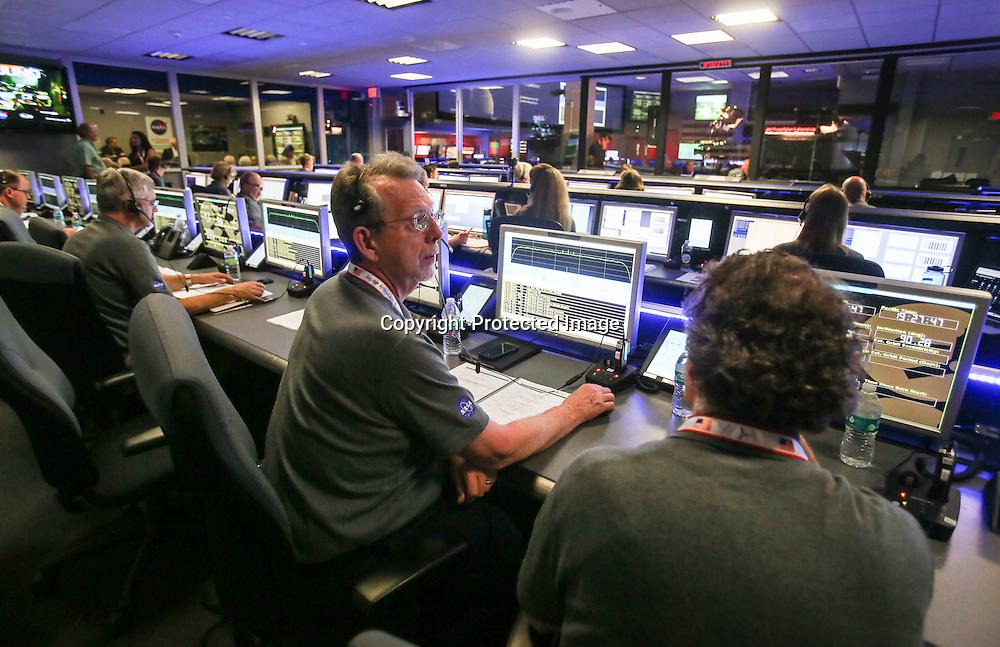 Staff members of Juno Mission watch on before the solar-powered Juno spacecraft went into orbit around Jupiter, at NASA's Jet Propulsion Laboratory in Pasadena, Calif., on July 4, 2016. (AP Photo/Ringo H.W. Chiu)
