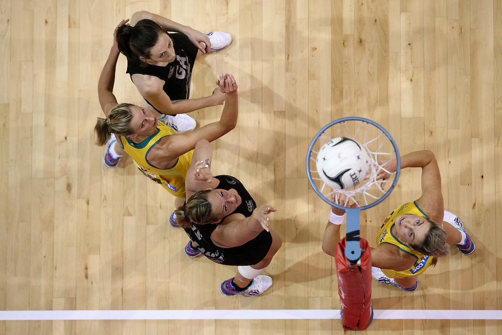 New Zealand's Bailey Mes, left, Australia's Laura Geitz, New Zealand's Cathrine Latu and Australia's Julie Corletto compete for the ball in the first international test match between Australia and New Zealand, New World Series, ILT Stadium, Invercargill, New Zealand, Thursday, October 02, 2014. Credit:SNPA / Dianne Manson