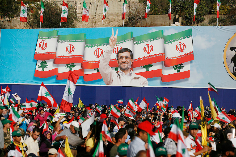 On the second and final day of his visit to Lebanon, Iranian President Mahmoud Ahmadinejad traveled to the southern town of Bint Jbeil. There a Hizballah-organized rally was held to welcome Ahmadinejad to the south Lebanon, an area where Hizballah is widely supported. Tens of thousands gathered for hours holding flags of Iran, Hizballah, Lebanon and other political parties, cheering the Iranian president as he arrived by helicopter from Beirut. ///A poster at the stadium in Bint Jbeil shows Iranian President Mahmoud Ahmadinejad.