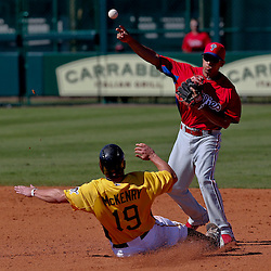 Mar 4, 2013; Bradenton, FL, USA; Pittsburgh Pirates catcher Michael McKenry (19) is forced out at second as Philadelphia Phillies second baseman Cesar Hernandez turns a double play to end the bottom of the fifth inning of a spring training game at McKechnie Field. Mandatory Credit: Derick E. Hingle-USA TODAY Sports