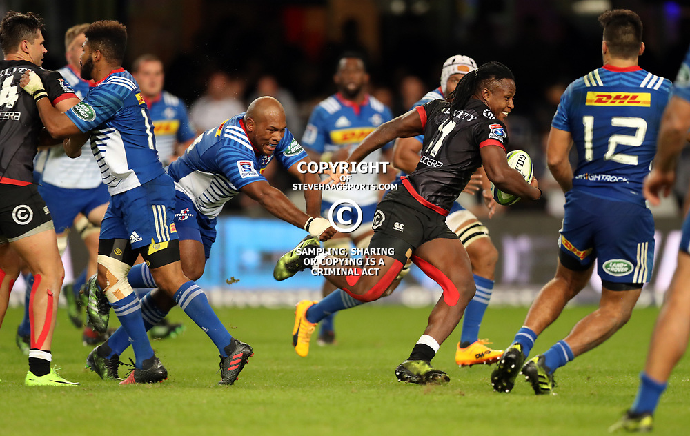 DURBAN, SOUTH AFRICA - MAY 27: Sbu Nkosi of the Cell C Sharks gets away from Bongi Mbonambi of the DHL Stormers during the Super Rugby match between Cell C Sharks and DHL Stormers at Growthpoint Kings Park on May 27, 2017 in Durban, South Africa. (Photo by Steve Haag/Gallo Images)