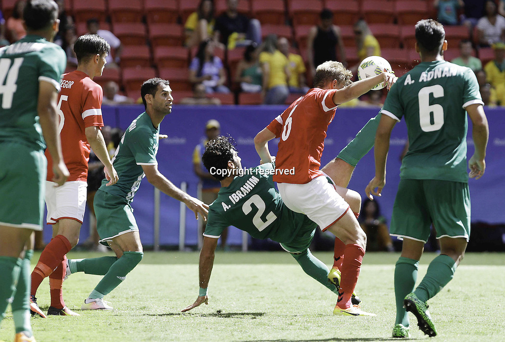 04.08.2016. Brasilia, Brazil. Ahmed Ibrahim Iraq in ball dispute with Andreas Maxso of Denmark during the match between Iraq (IRQ) versus Denmark (DEN), the first game of Football Group A Olympic mens tournament held at the Mané Garrincha Stadium, Brasilia.