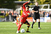 Josh Koroma of Leyton Orient (19) struggles to keep his balance after a challenge from Josh Falkingham of Harrogate Town (4) during the Vanarama National League match between Harrogate Town and Leyton Orient at Wetherby Road, Harrogate, United Kingdom on 22 September 2018.