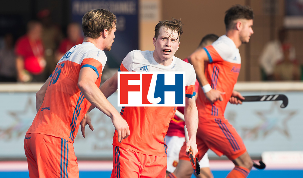 BHUBANESWAR -  Mirco Pruijser (Ned) heeft gescoord  tijdens  de Hockey World League Final wedstrijd Nederland-Spanje (2-3).  rechts Seve van Ass (Ned) COPYRIGHT  KOEN SUYK