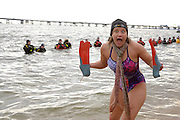 Becky Brensinger poses for a picture on the beach at Sandy Point State Park following the MSP Polar Bear Plunge in support of Special Olympics Maryland in Annapolis, MD on Saturday, January 29, 2011.
