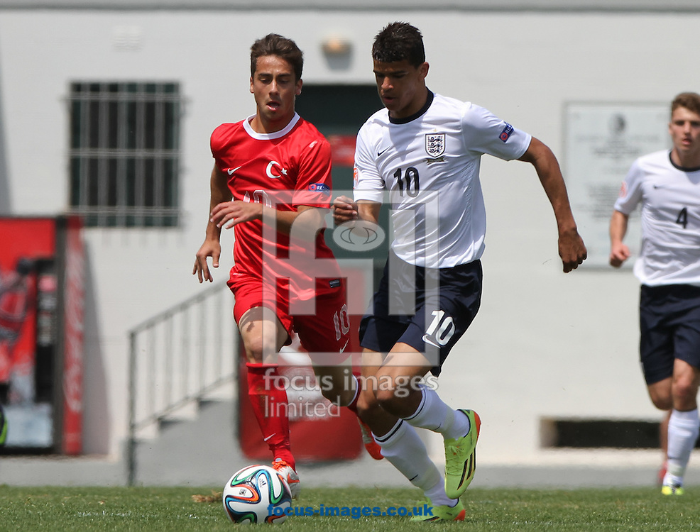 Dominic Solanke (centre right) of England and Emirhan Aydoğan (centre left) of Turkey battle for the ball during the 2014 UEFA European Under-17 match at Gozo Stadium, Xewkija<br /> Picture by Tom Smith/Focus Images Ltd 07545141164<br /> 12/05/2014