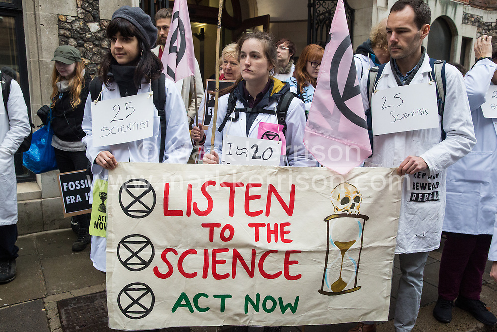 London, UK. 22 November, 2019. Climate activists from Scientists for XR gather outside the Department for Education during a demonstration intended to communicate the science relating to the climate and ecological emergency. Activists were dressed in labcoats to represent the 1600 scientists worldwide who have signed the Scientists Declaration in support of non-violent direct action against government inaction against the climate and ecological emergency.