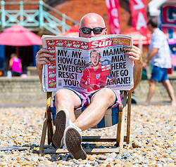 © Licensed to London News Pictures. 07/07/2016. Brighton, UK. Members of the public take the beach in Brighton and Hove ahead of the England game at the World Cup in Russia. (verbal permission granted) Photo credit: Hugo Michiels/LNP