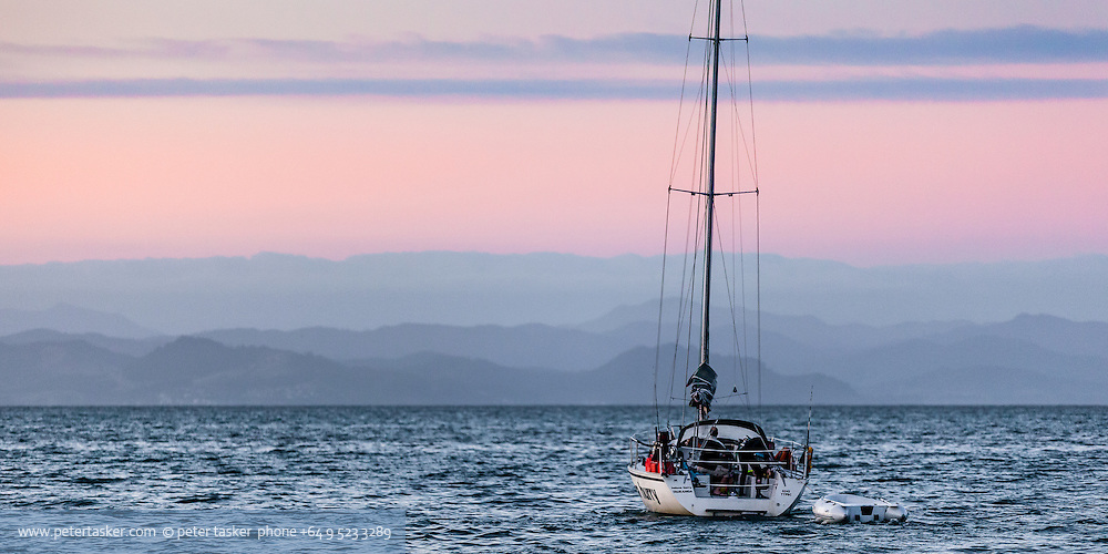 Yacht, heluva hurry from Tauranga, departing Great Mercury Island.  Coromandel Peninsular east coast in background.