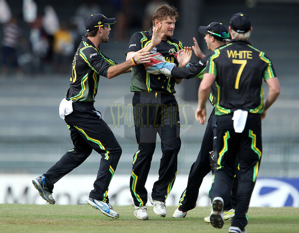 Shane Watson celebrates the wicket of William Porterfield (Captain) with the first ball of the match during the ICC World Twenty20 match between Australia and Ireland held at the Premadasa Stadium in Colombo, Sri Lanka on the 19th September 2012..Photo by Ron Gaunt/SPORTZPICS/INPHO