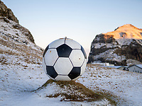 A large football by road. Vestmannaeyjar islands in winter. Iceland.