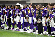 The Minnesota Vikings team stands for the National Anthem before the NFL week 6 regular season football game against the Arizona Cardinals on Sunday, Oct. 14, 2018 in Minneapolis. The Vikings won the game 27-17. (©Paul Anthony Spinelli)