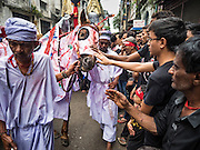 24 OCTOBER 2015 - YANGON, MYANMAR: Shia men and boys reach out to touch the horse that represents the horse Hussein rode into battle during Ashura observances at Mogul Mosque in Yangon. Ashura commemorates the death of Hussein ibn Ali, the grandson of the Prophet Muhammed, in the 7th century. Hussein ibn Ali is considered by Shia Muslims to be the third imam and the rightful successor of Muhammed. He was killed at the Battle of Karbala in 610 CE on the 10th day of Muharram, the first month of the Islamic calendar. According to Myanmar government statistics, only about 4% of the population is Muslim. Many Muslims have fled Myanmar in recent years because of violence directed against Burmese Muslims by Buddhist nationalists.    PHOTO BY JACK KURTZ