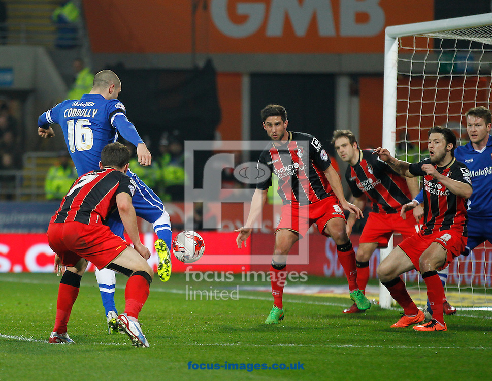 Matt Connolly of Cardiff City and Marc Pugh of Bournemouth during the Sky Bet Championship match at the Cardiff City Stadium, Cardiff<br /> Picture by Mike Griffiths/Focus Images Ltd +44 7766 223933<br /> 17/03/2015