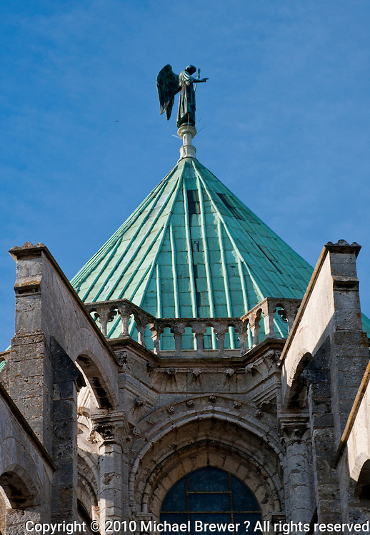 Our Lady of Chartres Cathedral, Chartres, France. A statue of a winged angel on the roof of the cathedral.