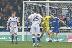PETERBOROUGH, ENGLAND - Saturday, February 19, 2011: Tranmere Rovers' Tony Warner pulls Peterborough United's George Boyd hair after Boyd tries to pick the ball out of the net during the Football League One match at London Road. (Photo by Gareth Davies/Propaganda)