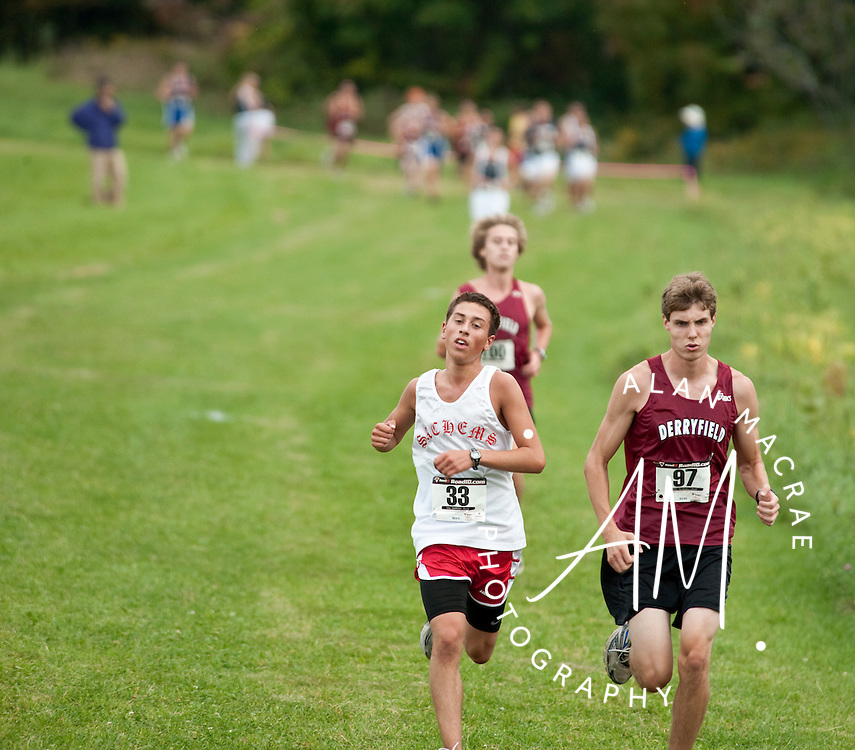 Laconia's Curtis Monier runs alongside Derryfield's Will Keller in Tuesday's invitational cross country meet at Robbie Mills Memorial Sports Complex in Laconia.  (Alan MacRae/for the Citizen)