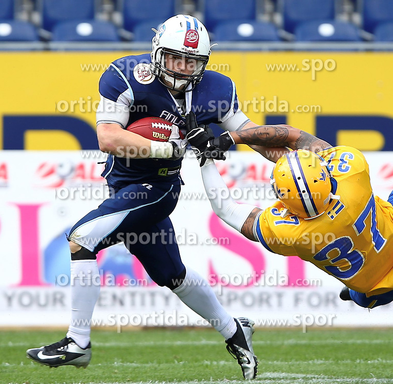 01.06.2014, NV Arena, St. Poelten, AUT, American Football Europameisterschaft 2014, Gruppe A, Finnland (FIN) vs Schweden (SWE), im Bild Veikka Lehtonen, (Team Finland, RB, #12) und  Rikard Robbins, (Team Sweden, DB, #37) // during the American Football European Championship 2014 group A game between Finland and Sweden at the NV Arena, St. Poelten, Austria on 2014/06/01. EXPA Pictures © 2014, PhotoCredit: EXPA/ Thomas Haumer