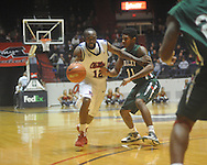 """Ole Miss guard Chris Warren (12)  is defended by Mississippi Valley State's D?Angelo Jackson (11) as he drives past Mississippi Valley State's Cor-J Cox (21) at C.M. """"Tad"""" Smith Coliseum in Oxford, Miss. on Monday, December 13, 2010."""