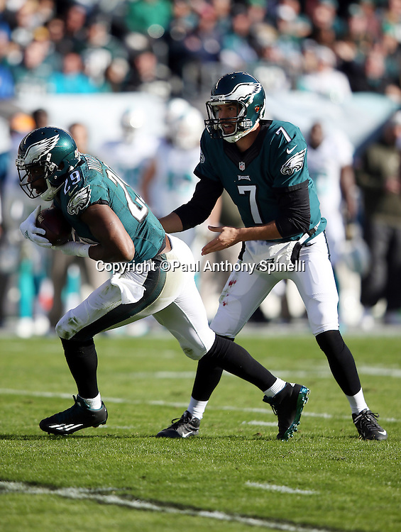 Philadelphia Eagles running back DeMarco Murray (29) takes a handoff from Philadelphia Eagles quarterback Sam Bradford (7) on a first quarter run for a first down to the Miami Dolphins 15 yard line during the 2015 week 10 regular season NFL football game against the Miami Dolphins on Sunday, Nov. 15, 2015 in Philadelphia. The Dolphins won the game 20-19. (©Paul Anthony Spinelli)