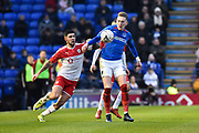 Ronan Curtis (11) of Portsmouth battles for possession with Alex Mowatt (27) of Barnsley during the The FA Cup match between Portsmouth and Barnsley at Fratton Park, Portsmouth, England on 25 January 2020.