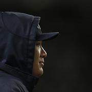 Masahiro Tanaka, New York Yankees, watching game two from the dugout on a bitterly cold night during the New York Yankees V Chicago Cubs, double header game two at Yankee Stadium, The Bronx, New York. 16th April 2014. Photo Tim Clayton