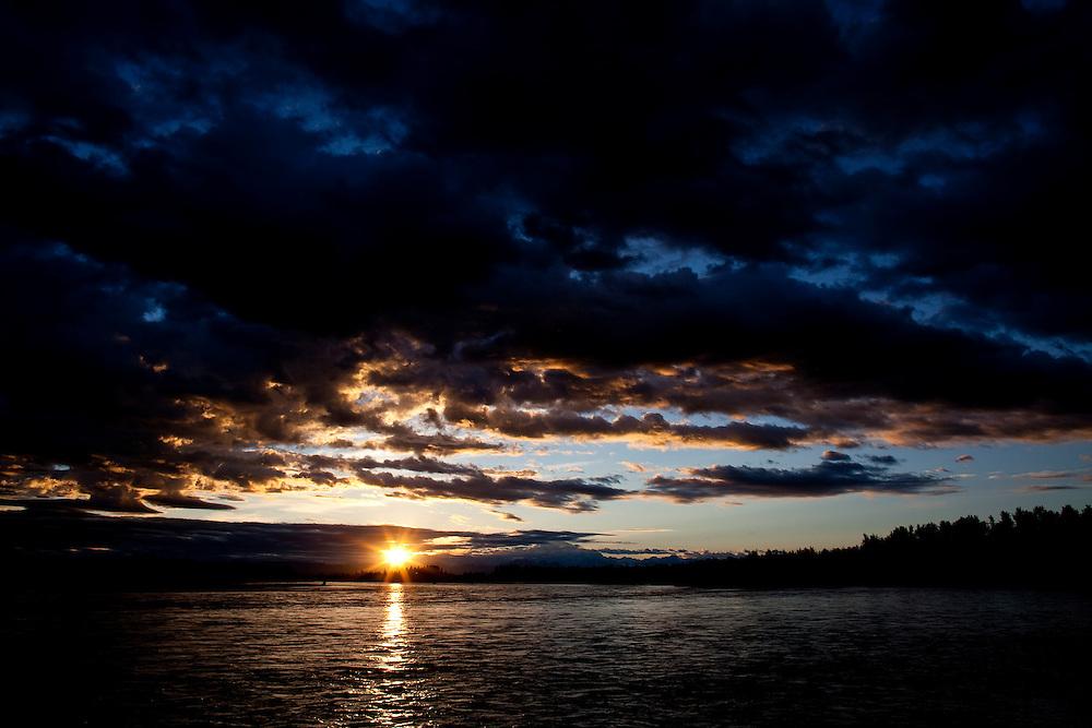 Alaska2010.-The sun sets over the Talkeetna River just outside of Denali National Park in Alaska.