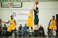 Vermont's Drew Urquhart (25) leaps to block the shot by Lyndon's Robbie Roulle (33) during the men's basketball game between the Lyndon State Hornets and the Vermont Catamounts at Patrick Gym on Saturday afternoon November 19, 2016 in Burlington (BRIAN JENKINS/for the FREE PRESS)