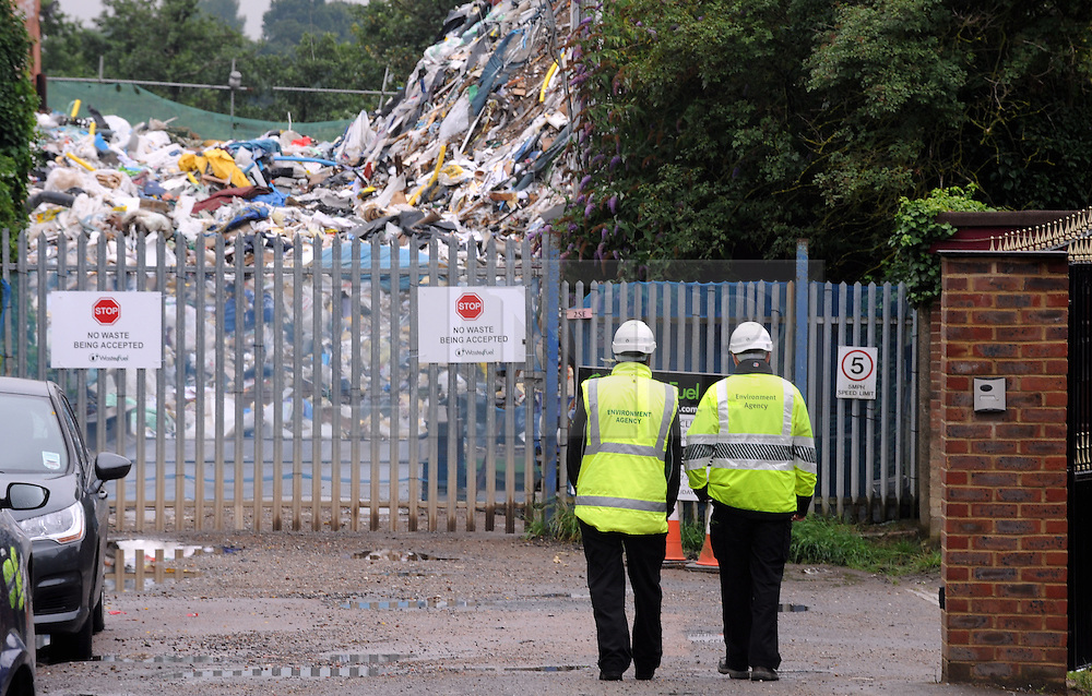 © Licensed to London News Pictures. 11/07/2014<br /> Environment agency officers on patrol outside the Waste4fuel Recycling site in St Pauls Cray,Kent.<br /> The Environment Agency has two officers posted out side the Waste4fuel site in Kent after local people reported seeing three lorry loads of waste being delivered on Monday (7.07.2014) to the St Pauls Cray site.  The Environment Agency has served an enforcement notice on Waste4Fuel to stop any further waste being brought into the site. <br /> This means any person depositing waste at Waste4Fuel will be committing an offence and may face action from the Environment Agency. <br /> Several conditions need to be met before further waste can be accepted at the site. <br /> The Environment Agency is waiting for a written decision from the High Court after it dismissed a contempt of court case last week for failure to maintain fire breaks and store new waste separately at the site. <br /> <br /> (Byline:Grant Falvey/LNP)
