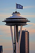 A No. 24 flag atop the Space Needle honors Seattle Mariners great Ken Griffey Jr., who was elected to the National Baseball Hall of Fame. (Ken Lambert / The Seattle Times)